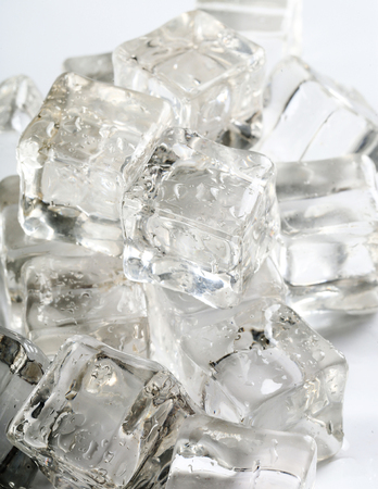 refrigerate: Frozen water. Ice cubes on the table Stock Photo