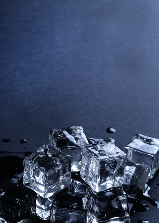 water frozen: Frozen water. Ice cubes on the table Stock Photo