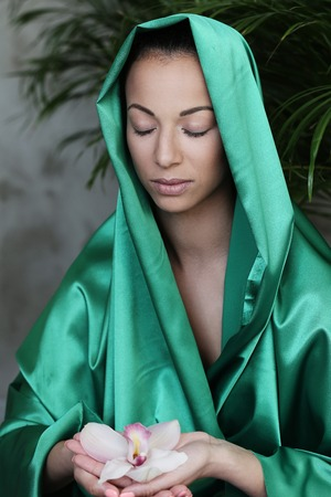 mouth cloth: Care. Woman in green fabric