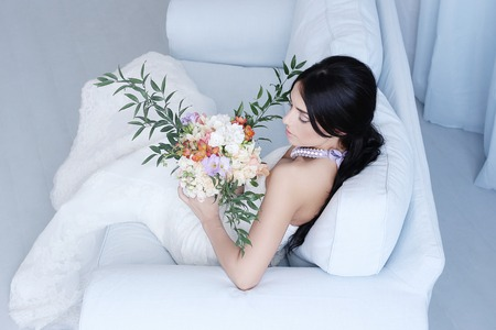 life event: Wedding. Lovely bride with beautiful bouquet Stock Photo