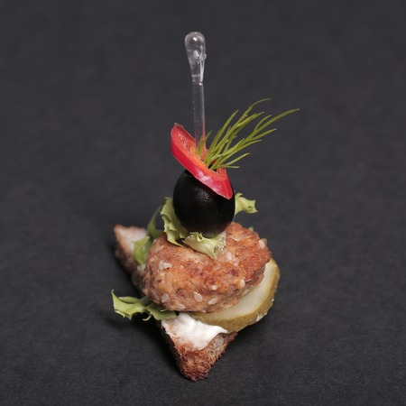 penetrated: Food. Delicious appetizer on a black background Stock Photo