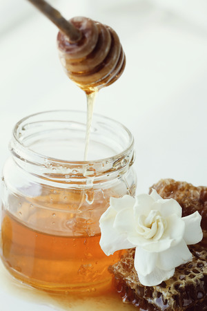 drizzler: Natural food. Delicious honey in a jar Stock Photo