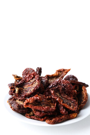 desiccated: Sun-dried tomato on a white background