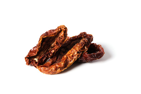 sundried: Sun-dried tomato on a white background