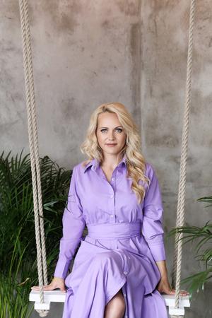 purple dress: Beautiful woman in purple dress