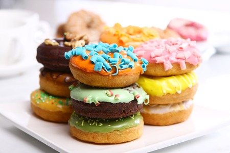 Sweet food. Delicious doughnuts on the table Stock Photo