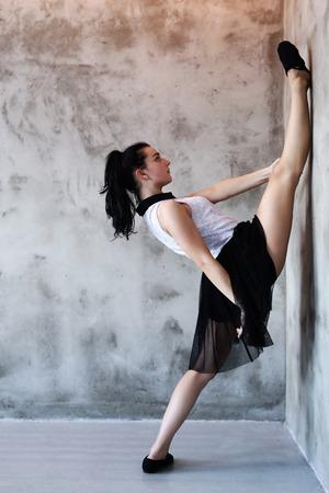 Flexible woman in the dance studio