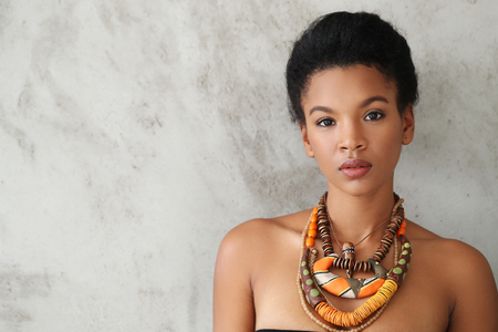 brown skin: Beauty. Lovely woman with necklace