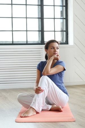 Fitness. Woman during pilates workout