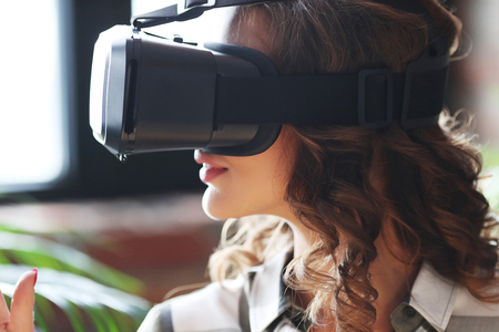 Technology. Lovely woman with VR headset Stock Photo - 63999297