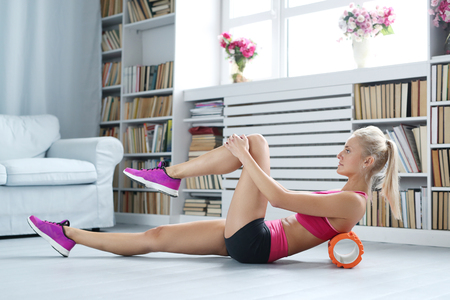 hair roller: Workout. Woman exercise at home