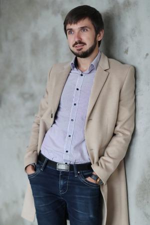 Fashion. Handsome man in coat
