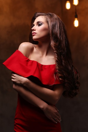 dressy: Woman in red dress with gorgeous, curly hairdo