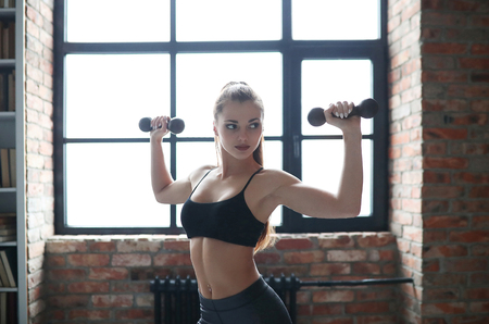 navel piercing: Woman in the gym Stock Photo