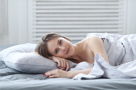 hotel bedroom: Woman in bed Stock Photo