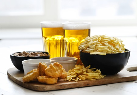 Alcohol and food. Beer with snacks on the table