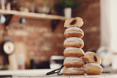powdered: Food. Freshly baked doughnuts on the table