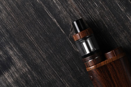 glycerin: Vaping device on the wooden table
