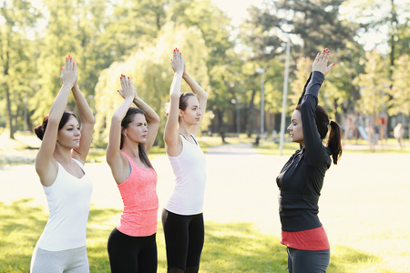 women having outdoor exercise Stock Photo