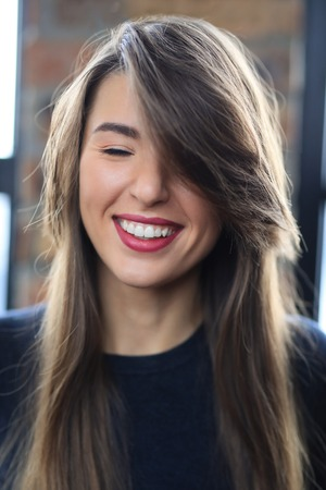 Happy woman with red lipstick