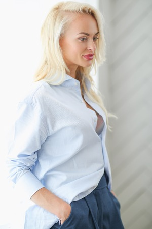 Woman in blue shirt Stock Photo