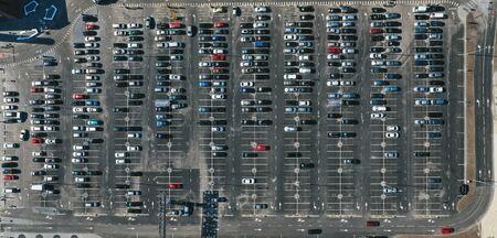 Birds-eye view of the parking lot that is captured with a drone