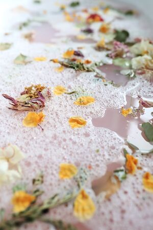 Bath with flower petals