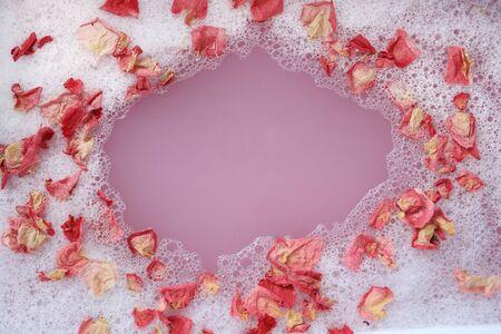 Bath with foam and flower petals Banco de Imagens