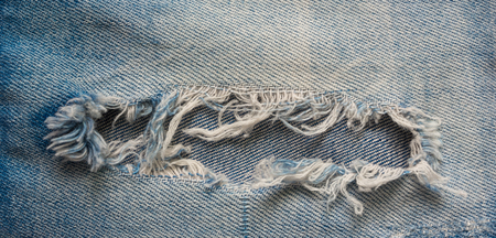 ripped jeans: blue faded old ripped jeans closeup, scrapes