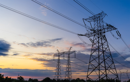 powerhouse: Power Line. pylon against a blue sky.