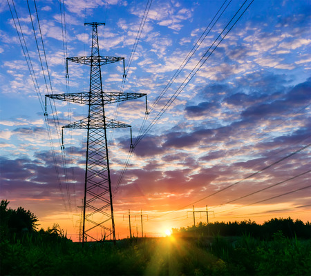 Power lines on a colorful sunrise ,Electric power lines against sky at sunrise.