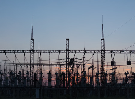 hight: Hight voltage tower in rural landscape with blue sky Stock Photo