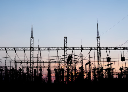 over voltage: Electrical substation silhouette on the dramatic sunset background