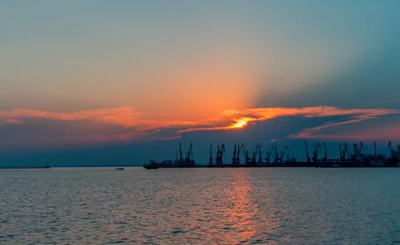 shipbuilding: Silhouette of sea cargo port with cranes.