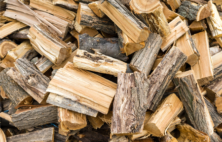 stack of firewood: Firewood background - chopped firewood on a stack