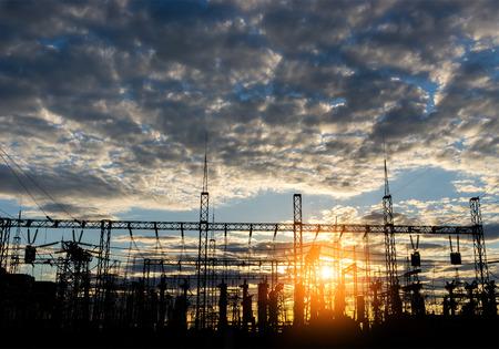 regulators: distribution electric substation pylon with lines, at sunset.