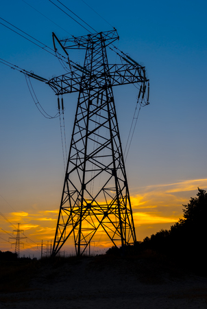 silhouette of electric pylon at sunset with beautiful sky