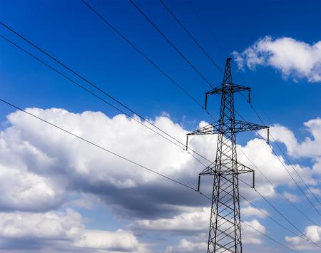 High voltage electricity pylon system on the sky background.