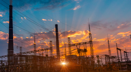 silhouette of coal electric power plant on the background of a beautiful sunset