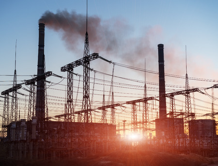 condensers: silhouette of coal electric power plant on the background of a beautiful sunset