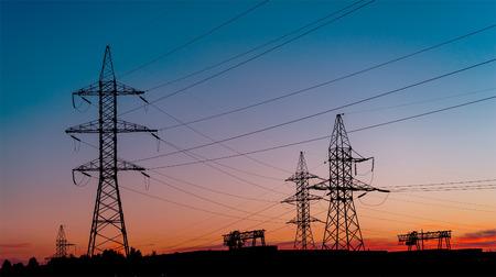 electricity providers: Power Line. pylon against a blue sky.