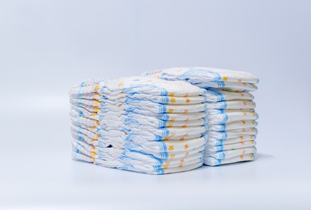 Stacks of diapers stacked in staggered rows on a white background.
