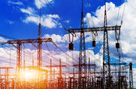 Sun setting over an electrical substation closeup Stock Photo