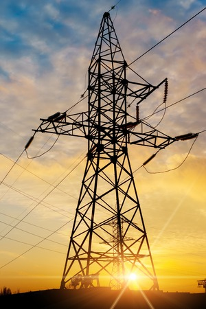 distribution electric substation with power lines and transformers, at sunset Stock Photo