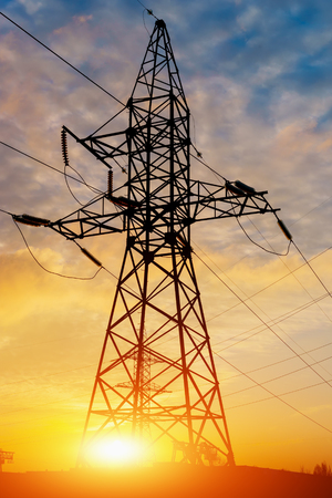 silhouette of high voltage electrical pole structure Stock Photo