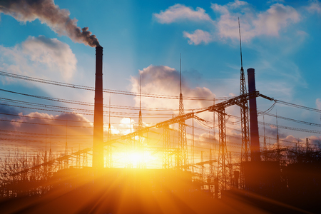 megawatt: Thermal power stations and power lines during sunset Stock Photo