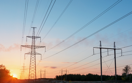 power cables: high-voltage power lines at sunset. electricity distribution station. high voltage electric transmission tower.