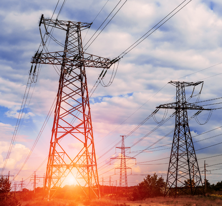 transmit: Electricity pylons at sunset and a beautiful blue sky