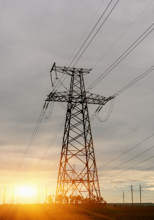 electric grid: high voltage post. High-voltage tower sky background Stock Photo