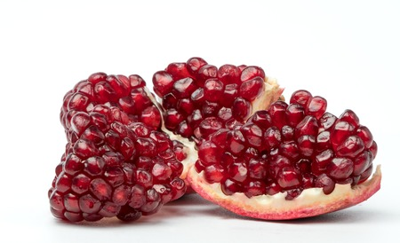 Red ripe pomegranate on a white background.